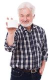 Handsome elderly man with paper Stock Photo