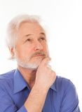 Handsome elderly man thoughtful Stock Photography