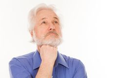 Handsome elderly man thoughtful Royalty Free Stock Photography
