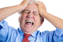 Handsome elderly man with white hair in blue shirt and red tie, stressed and frustrated with raging headache Stock Photos