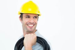 Handsome electrician carrying wires Royalty Free Stock Images