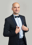 Handsome elegant bald man in suit and bow tie Royalty Free Stock Images