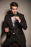 Handsome elegant business man drinking a glass of champagne Royalty Free Stock Photography