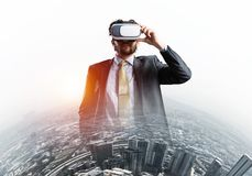 Handsome elegant businessman experiencing impressive virtual reality and business city at backdrop stock photos