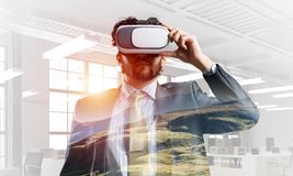 Handsome elegant businessman experiencing impressive virtual reality. Mixed media royalty free stock photos