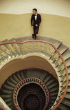 Handsome elegant guy standing on the old fashioned stairs Royalty Free Stock Photography