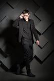 Handsome elegant man in black suit with glasses. Success Stock Photos