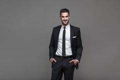 Handsome elegant man on grey background Royalty Free Stock Image