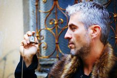 Handsome elegant man with pocket watch and wolf fur. Handsome elegant man with pocket watch and wolf fur Royalty Free Stock Images