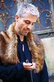 Handsome elegant man with pocket watch and wolf fur.  Royalty Free Stock Photography