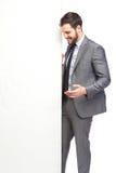 Handsome elegant man showing panel Royalty Free Stock Photos
