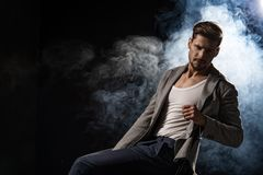 Handsome elegant man. Elegant handsome man in smoke Royalty Free Stock Photography