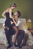 Handsome elegant man undressing woman stock image