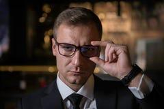 Handsome elegant serious Caucasian businessman looking at camera stock photos