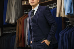 Handsome elegant young fashion man in classical costume suit. Advertising photo Royalty Free Stock Photos