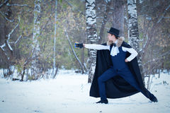 Handsome  elegantyoung man with rapier, outdoor Stock Images