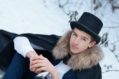 Handsome  elegantyoung man with rapier, outdoor Royalty Free Stock Photography
