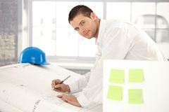 Handsome engineer drawing plans Royalty Free Stock Images