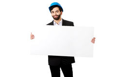 Handsome engineer in helmet holding empty banner. Stock Images