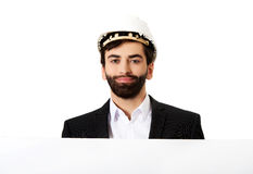 Handsome engineer in helmet holding empty banner. Smiling businessman with hard hat holding empty banner Royalty Free Stock Photos