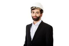 Handsome engineer in protective helmet. Stock Image