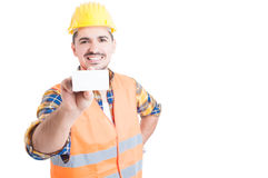 Handsome engineer showing blank business card and smiling Stock Photos
