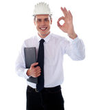 Handsome engineer showing okay gesture Stock Image