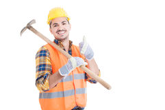 Handsome engineer showing thumb up or like gesture holding shove Stock Image