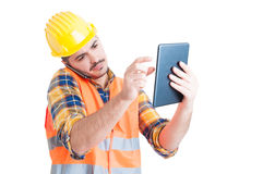 Handsome engineer talking on the phone and holding a tablet Royalty Free Stock Photo
