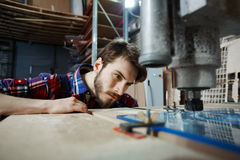 Handsome Engineer watching Glass Cutting Process Royalty Free Stock Photos