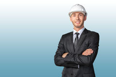 Handsome engineer in white hardhat Stock Image