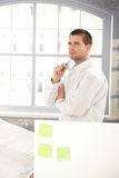 Handsome engineer working in office Royalty Free Stock Photo