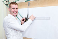 Handsome engineering worker near panel board Royalty Free Stock Image