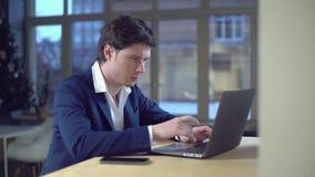 Handsome entrepreneur chatting online stock footage