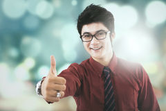 Handsome entrepreneur shows thumb up Stock Photos