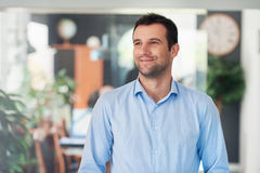 Handsome entrepreneur thinking up new business ideas Royalty Free Stock Image