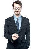 Handsome entrepreneur using mobile phone Stock Photography