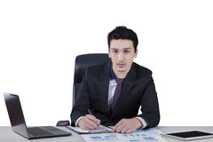Handsome entrepreneur working on the desk Stock Photos