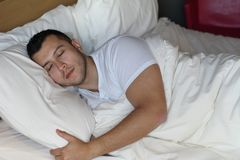 Handsome ethnic male sleeping comfortably.  Royalty Free Stock Image