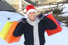 Handsome ethnic man shopping presents. Handsome ethnic man shopping present for his loved ones Stock Images