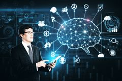 Artificial intelligence and brainstorm concept. Handsome european businessman using smartphone with abstract AI interface on night city background. Artificial stock photo