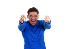 Handsome excited energetic student screaming with joy with his fists in the air Royalty Free Stock Photos