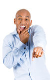 Handsome excited man happy smile with blue shirt pointing finger towards at you Stock Image