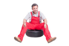 Handsome and excited mechanic showing like or thumbs-up Stock Photo