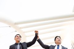 Handsome executive businessman hold his employee, business young royalty free stock photo