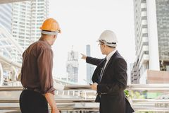 Handsome executive engineer is pointing finger to construction a royalty free stock images