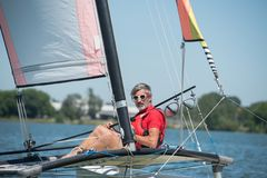 Handsome experienced sailor having fun on lake Stock Photo