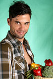 Handsome farmer holding vegetables Stock Photography