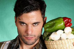 Handsome farmer holding vegetables Stock Image