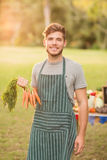 Handsome farmer smiling at camera Royalty Free Stock Image